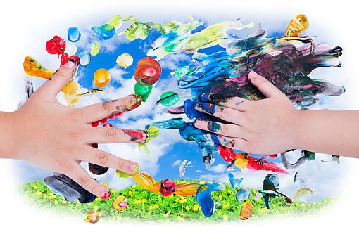 Closeup Of Little Children Hands Doing Finger Painting With Vari